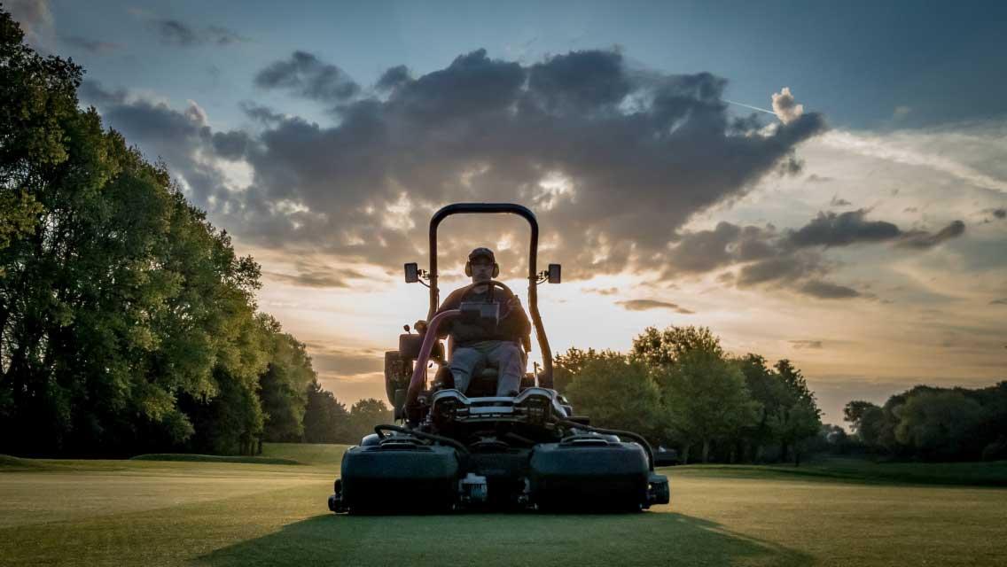 Royal Norwich Greenkeeper cutting grass